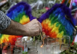 AP Photo by Julie Jacobson for Macleans http://www.macleans.ca/news/world/how-homophobia-has-complicated-the-grieving-process-in-orlando/