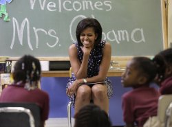 MICHELLE OBAMA with Students at Ferebee-Hope Elementary School, Photo from Business Insider